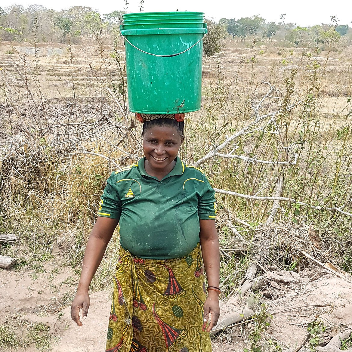a05-woman-carrying-bucket-of-water-on-head
